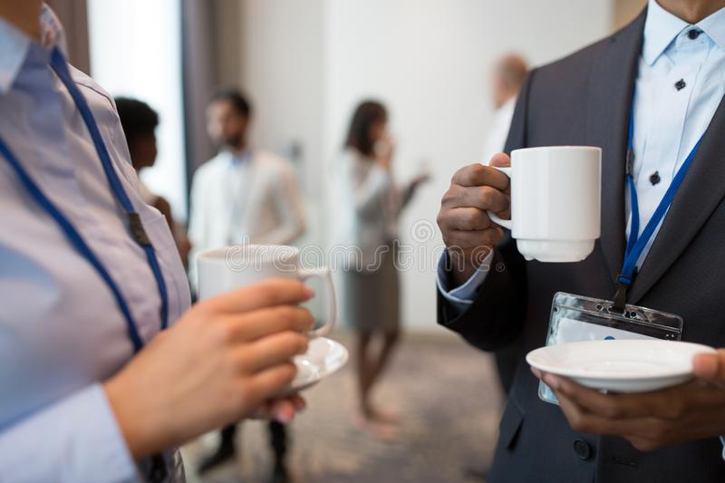 Business people with conference badges and coffee royalty free stock photography