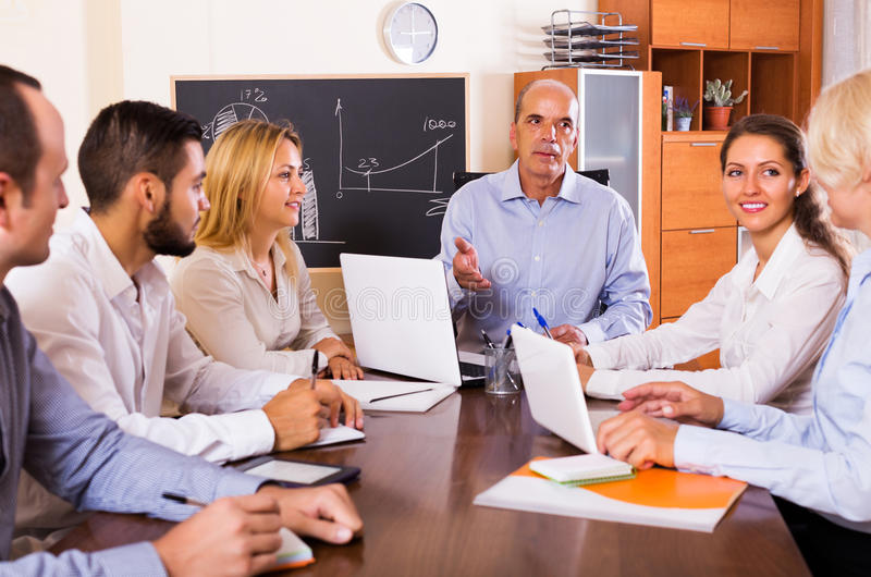 Business people during conference call. Happy adult business people during conference call indoors stock images