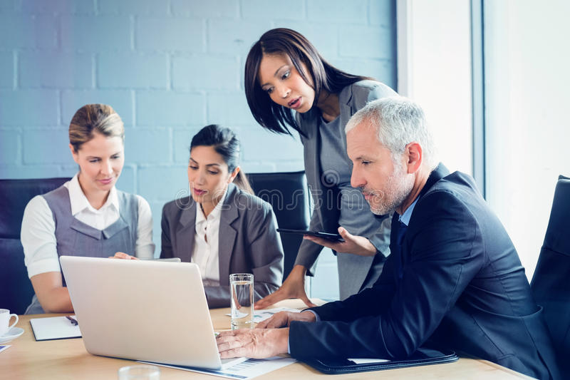 Business people in conference room royalty free stock image