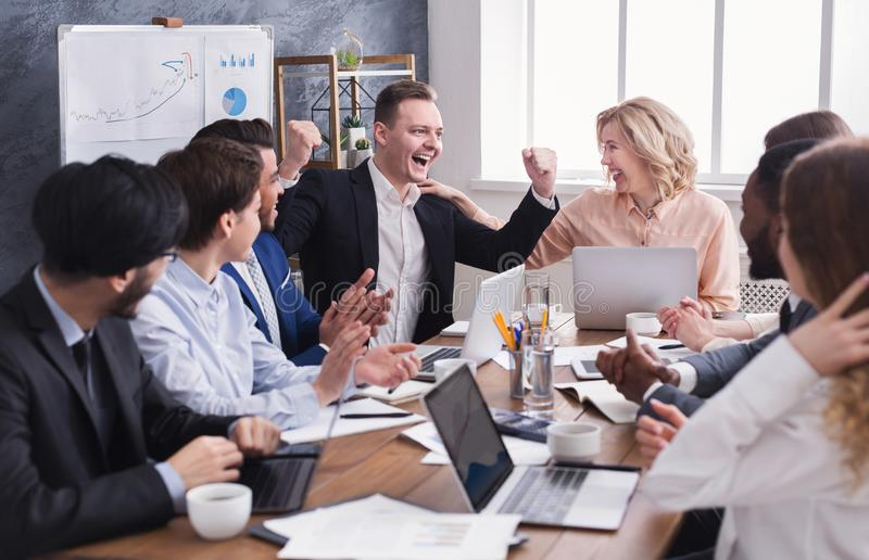 Business people congratulate colleague with his success royalty free stock images