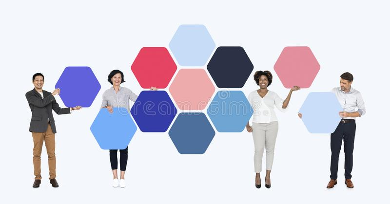 Business people with connected hexagon boards royalty free stock image