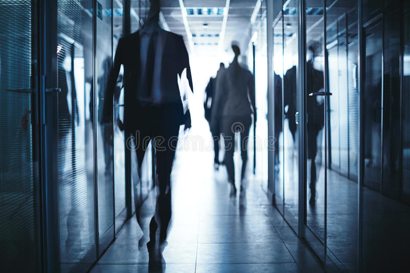 Business people in corridor royalty free stock photo