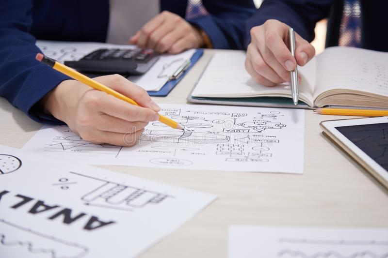 Business people creating business plan stock photography