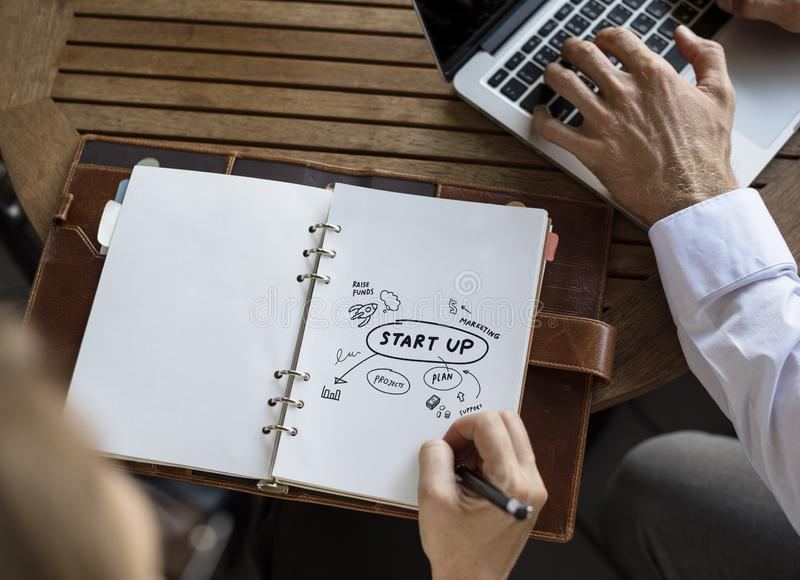 Business people creating a startup plan royalty free stock image