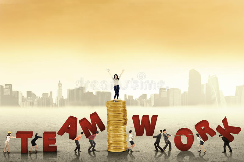 Business people creating word of teamwork royalty free stock image