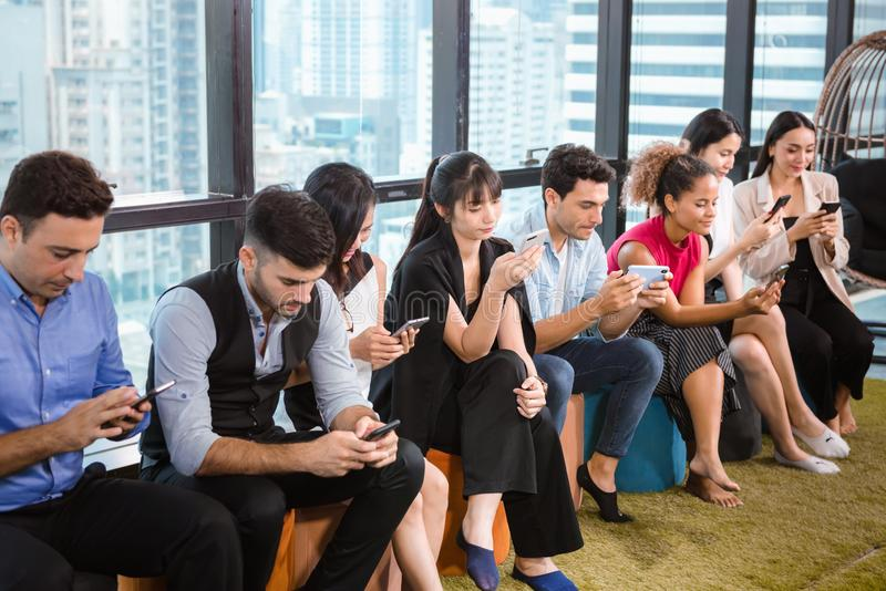 Business People and Creative Design Concentrated Playing With Own Smartphone While Meeting Break. Technology Social Media and stock photo