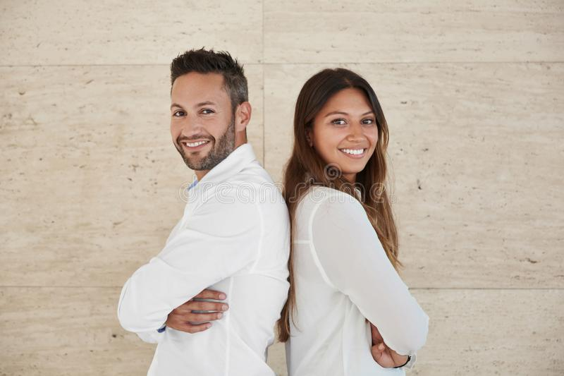 Business people with crossed arms leaning against each other back royalty free stock image