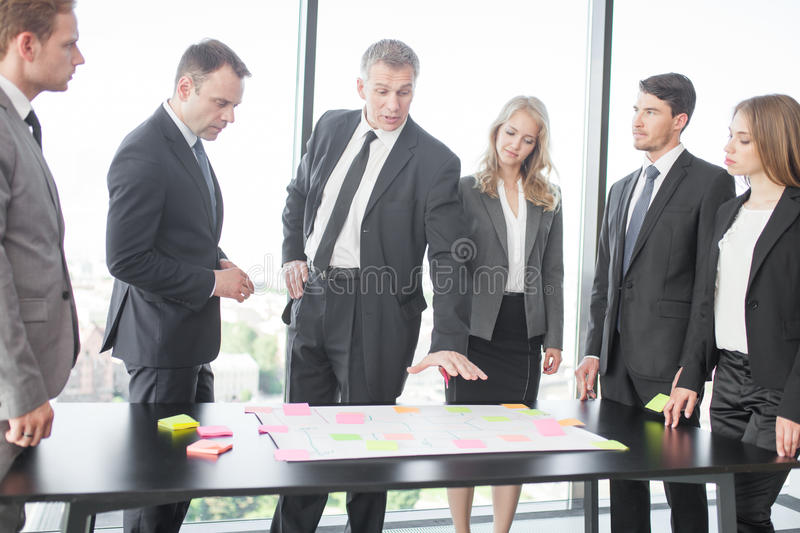Business people developing plan on office desk stock photo