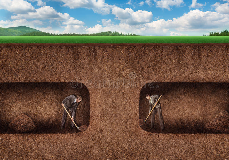 Business people dig a tunnel underground royalty free stock photo