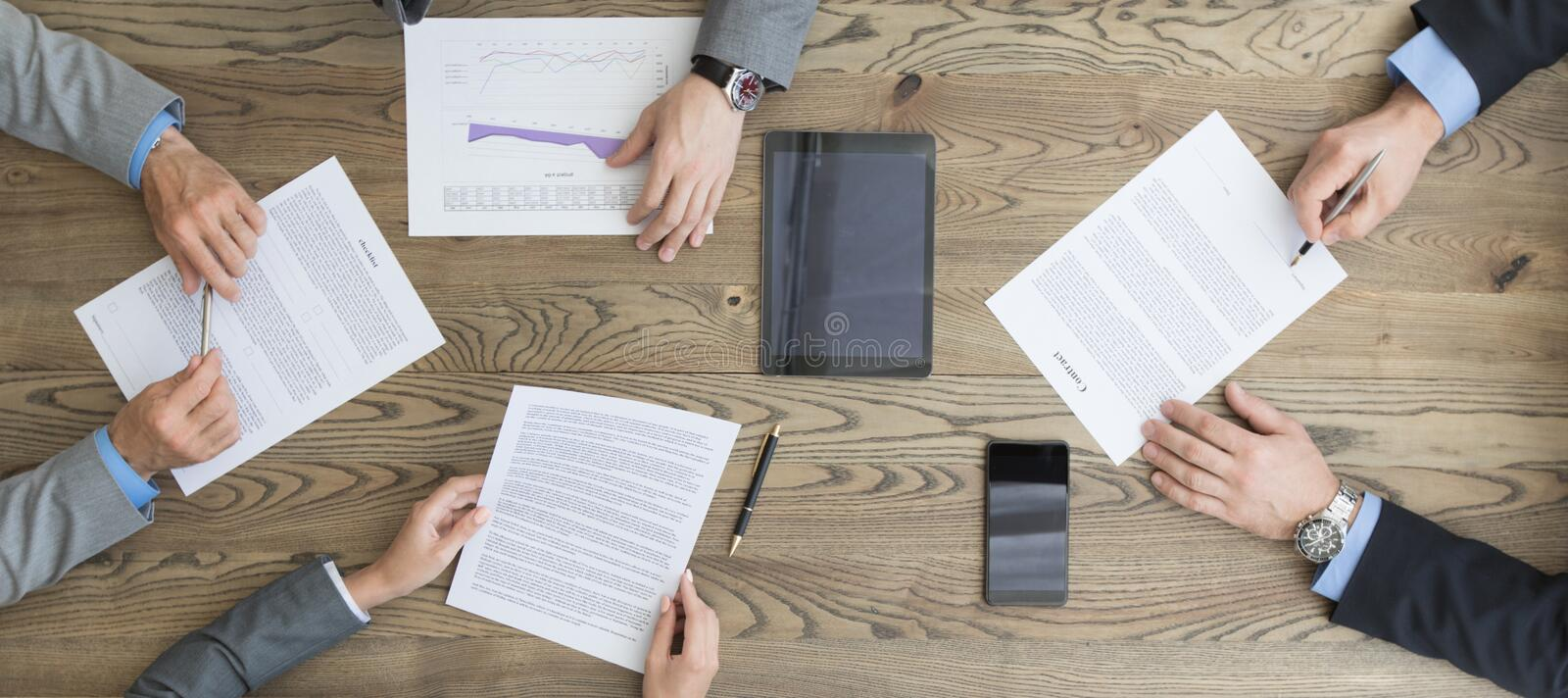 Business people discuss contract stock image