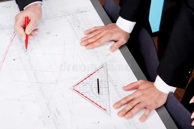 Business people discussing architecture plan sketch. In office stock photo