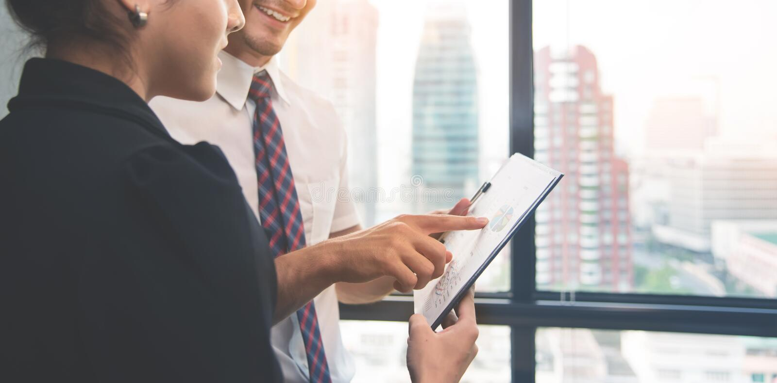 Business people discussing with chart graph documents at office stock image