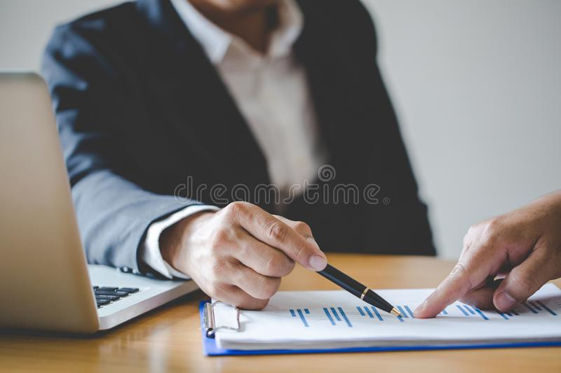 Business people discussing the charts and graphs showing the results of their successful teamwork, Concept picture for stock royalty free stock photos