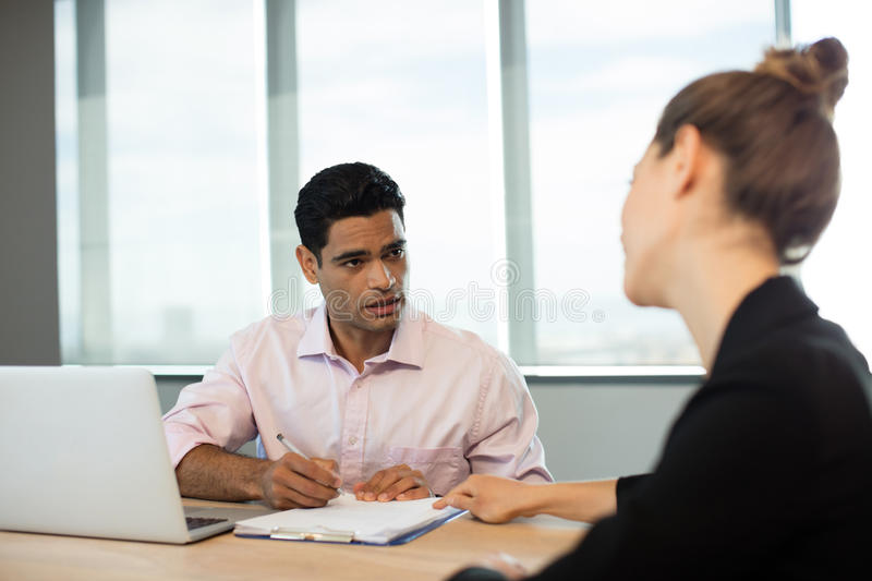 Business people discussing contract during meeting stock photography