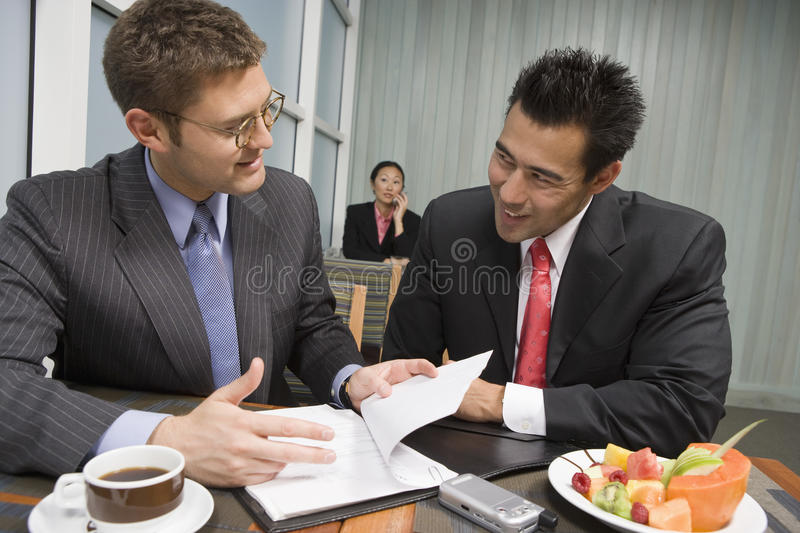Business People Discussing Contract In The Restaurant royalty free stock photos