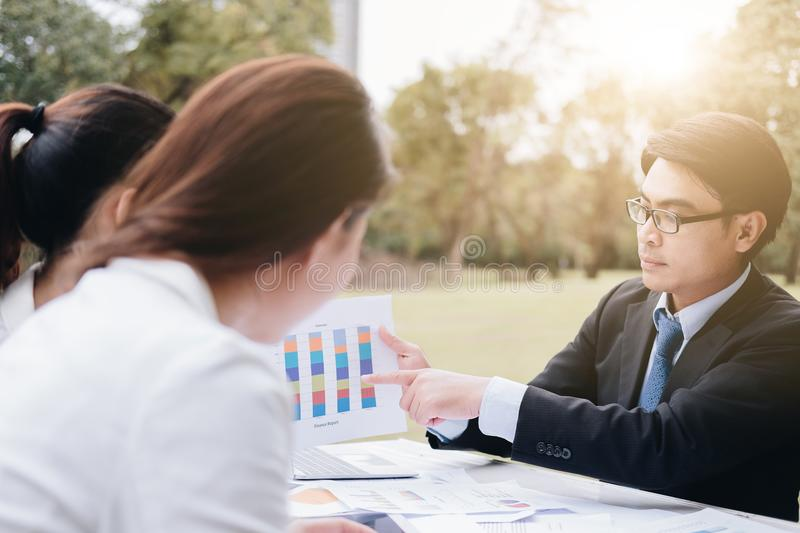 Business people discussing ideas at meeting using laptop in the royalty free stock photo
