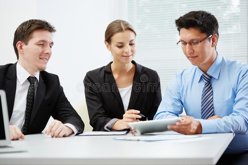 Business people working with tablet computer stock photos