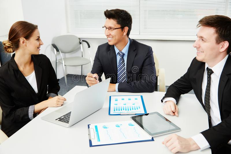 Business people working with laptop royalty free stock image
