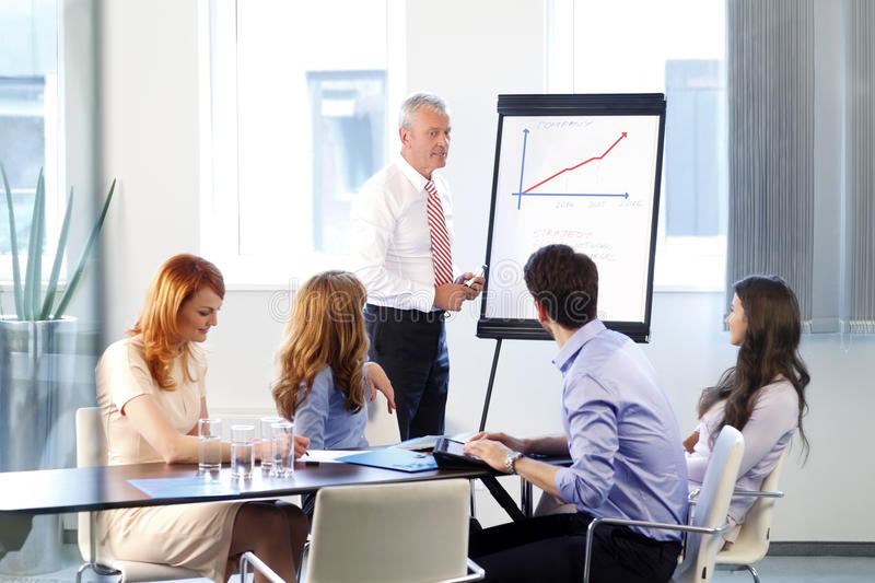 Business people discussing at meeting stock image
