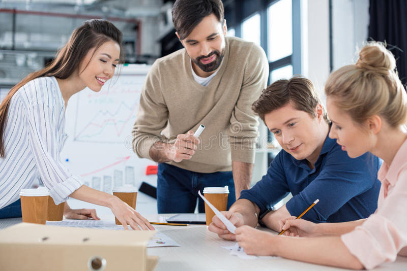 Business people discussing new business plan on small officemeeting. Group of young business people discussing new business plan on small officemeeting stock photos