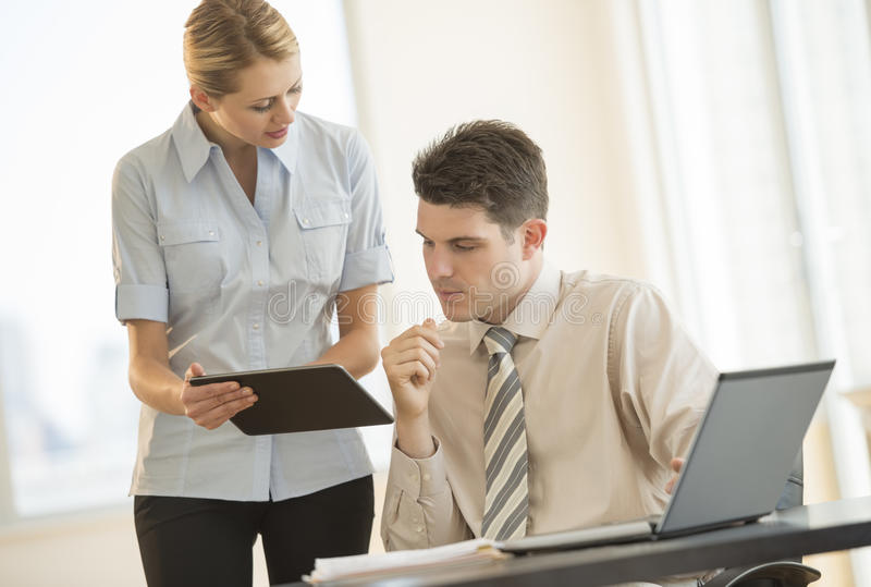 Download Business People Discussing Over Digital Tablet In Office Stock Image - Image: 32429833
