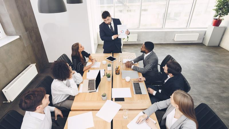 Business people discussing results of their teamwork stock image