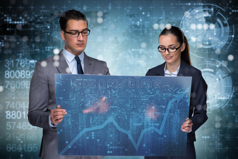 The business people discussing stock chart trends. Business people discussing stock chart trends stock images
