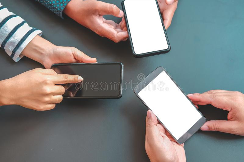 Business people discussing using smart mobile phone stock photography