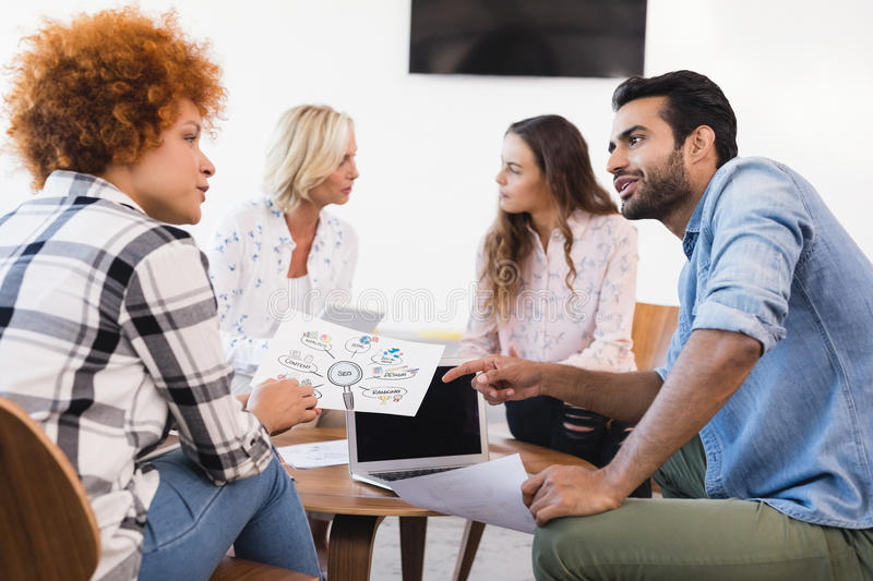 Business people discussing while working together royalty free stock photography