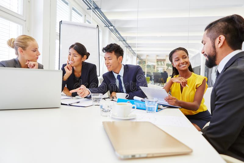 Business people discussing in workshop royalty free stock photography