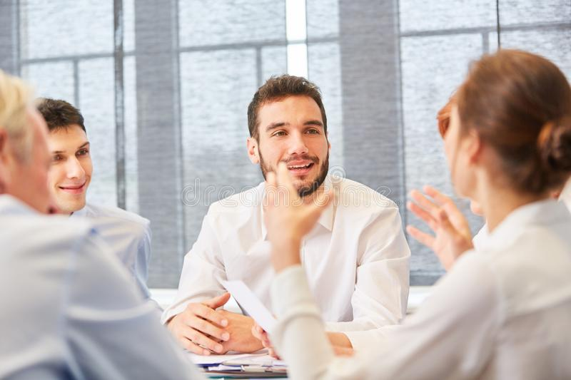 Business people in a discussion. Planning and talking as a team stock photography