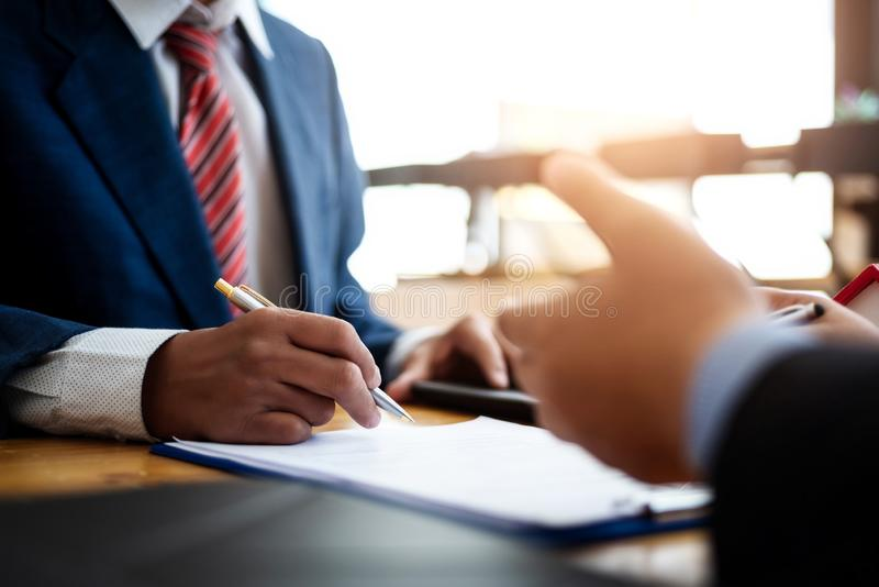 Business people discussion and negotiating investment housing estate with sign a contract term loan facility in office. contract royalty free stock photography