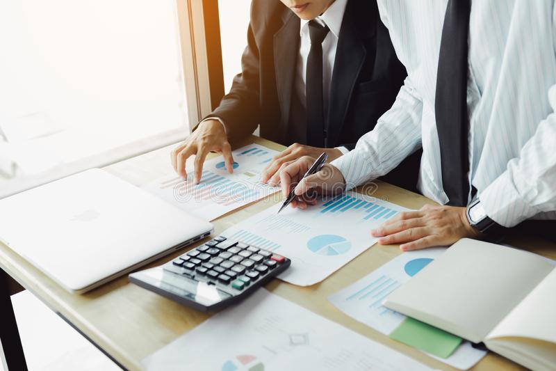Business people discussion about summary report graph and calculation financial budget in office room stock photo