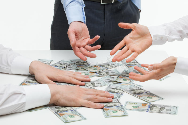 Business people dividing money. White background stock images