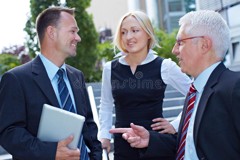 Business people doing small talk royalty free stock photos