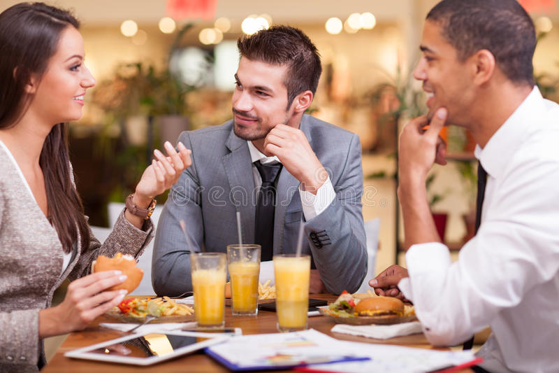 Business people enjoy in lunch at restaurant royalty free stock images