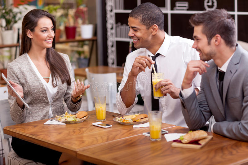 Business people enjoy in lunch at restaurant. Three Business people Having Meeting In Outdoor Restaurant stock images