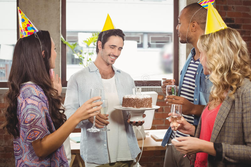 Business people enjoying at birthday party royalty free stock images