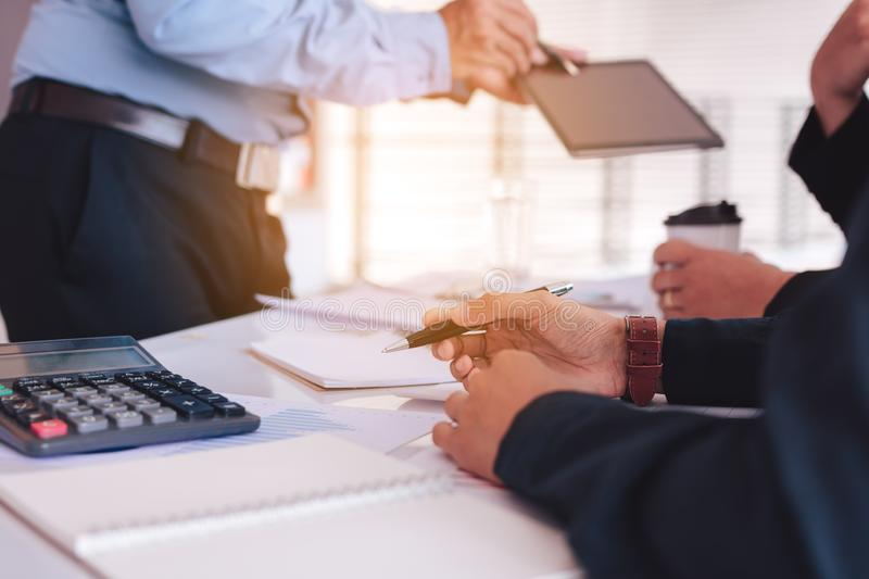 Business people examining financial reports and analyzing business growth royalty free stock photos