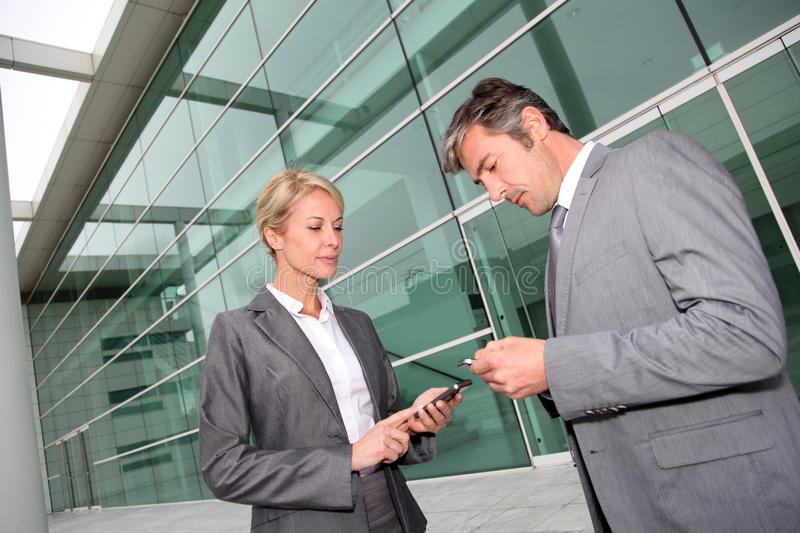 Business people exchanging contact numbers stock photos