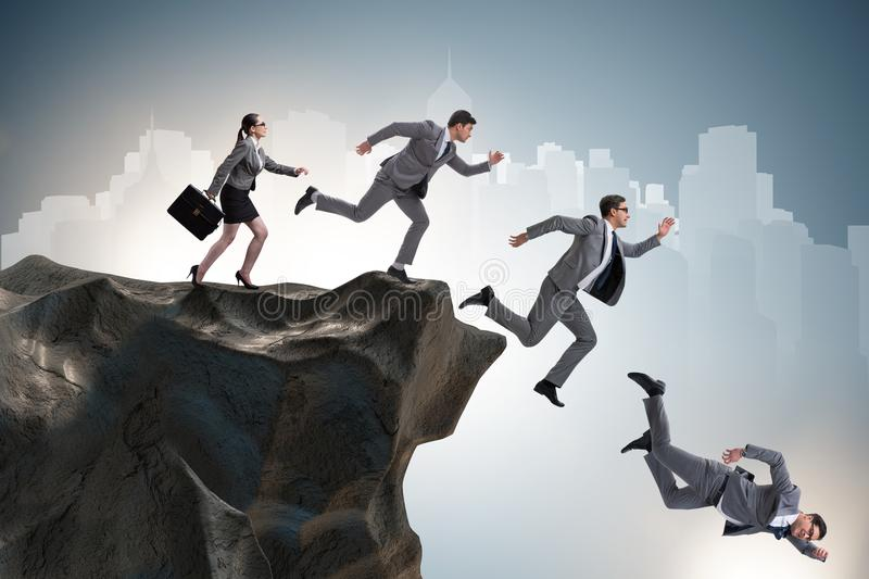 Download The Business People Falling Off Cliff Stock Photo