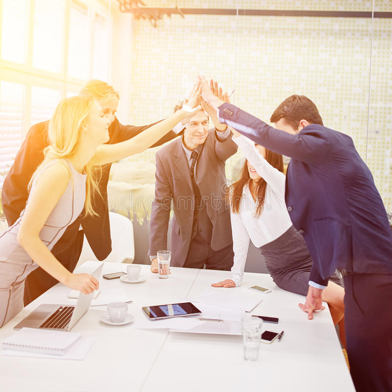 Business people give each other a high five royalty free stock images
