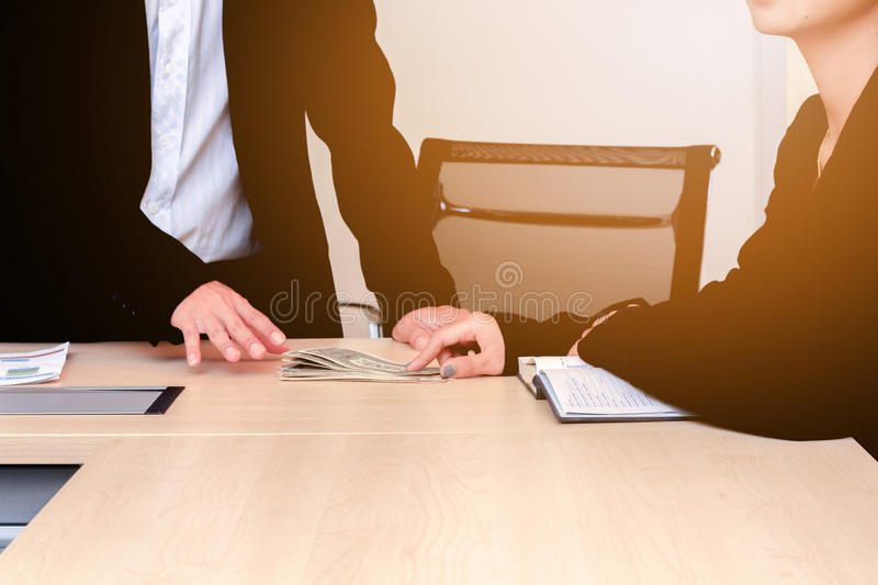Business people give money in office. stock photos