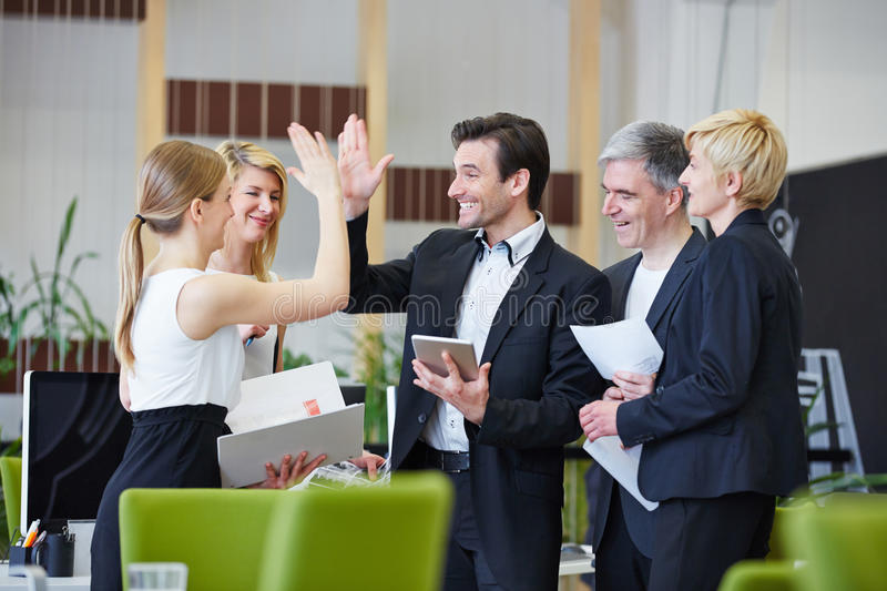 Business people giving high five stock photo