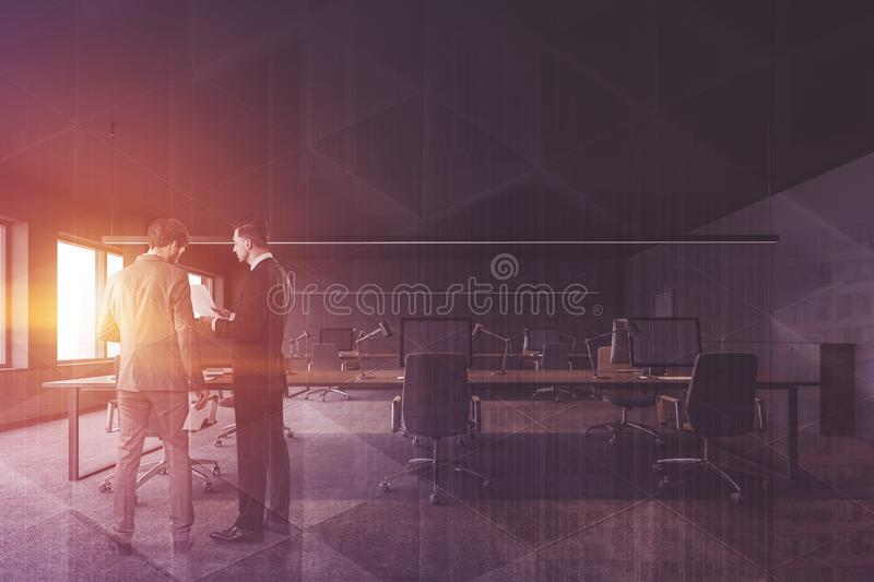 Business people in gray office interior stock images
