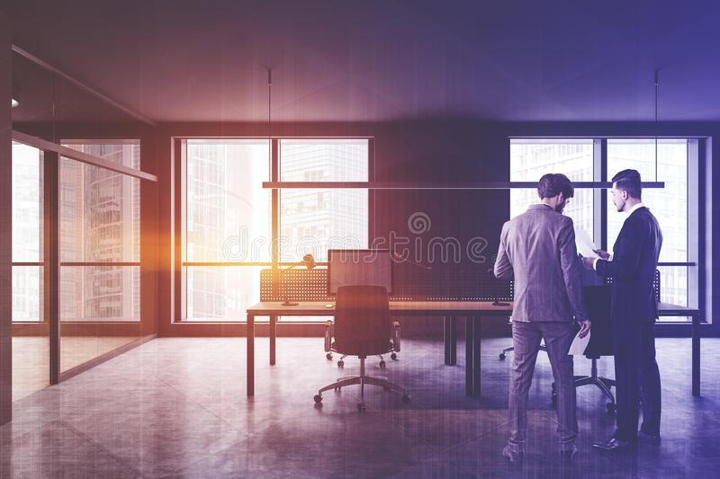 Business people in gray open space office stock photography