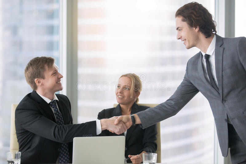 Business people greeting each other stock image image of handshake download business people greeting each other stock image image of handshake group 82135649 m4hsunfo