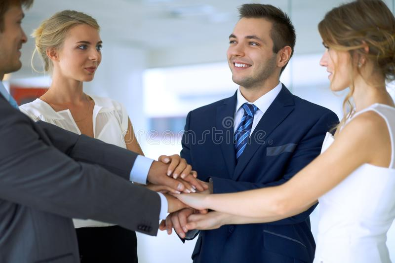 Business people group joining hands stock photos