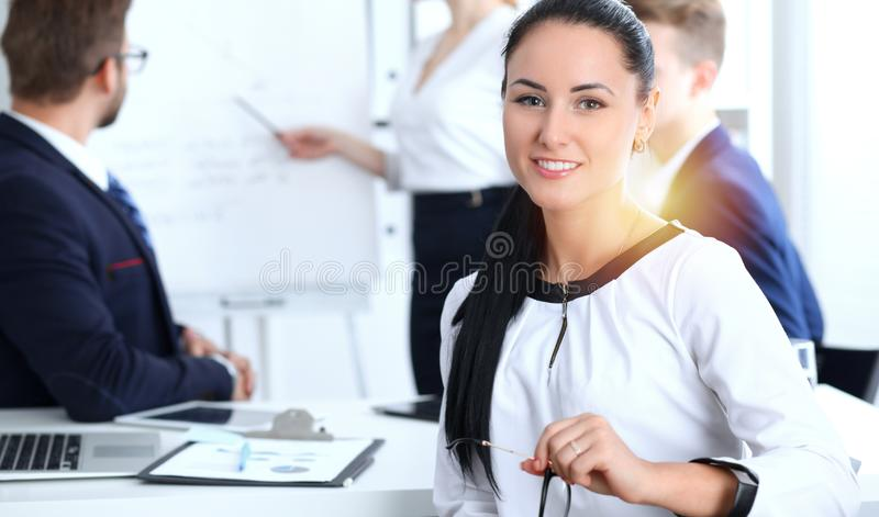 Business People group at meeting in office. Focus at beautiful cheerful smiling businesswoman. Conference, corporate stock photography