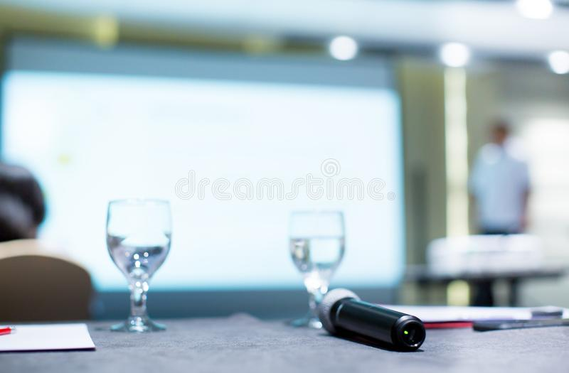 Business people group at meeting seminar presentation. Speaker gives speech in conference hall. Lecturer at conference. royalty free stock photography